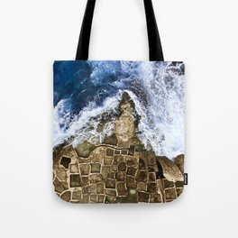An abstract of the ocean and the coastal rocks. Tote Bag