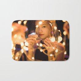 Woman Through String of Lights Bath Mat
