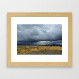 Approaching storm in the desert Framed Art Print