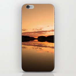 Beautiful sunset - glowing orange - forest silhouette and reflection iPhone Skin
