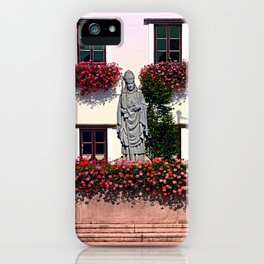 A saint and lots of flowers iPhone Case