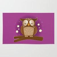 hedwig Area & Throw Rugs featuring Sleepy brown barn owl by Jazzydevil