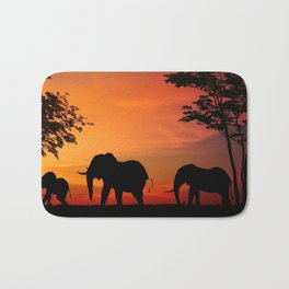 Elephants in the African sunset Bath Mat