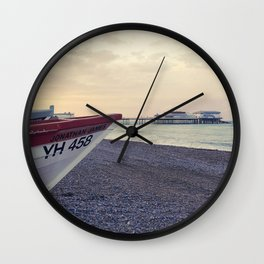Boat on the shore Wall Clock