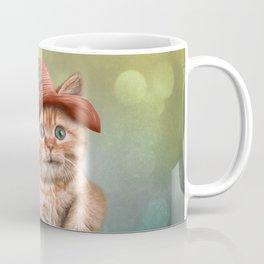 Little funny striped kitten in a big hat Coffee Mug