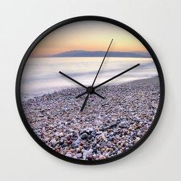 little stones at sea sunset Wall Clock