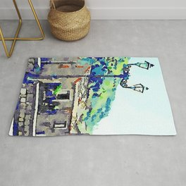 Low wall buildings and lamppost Rug