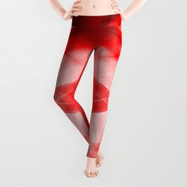 Bright warm triangular strokes of intersecting sharp lines with scarlet triangles and a star. Leggings