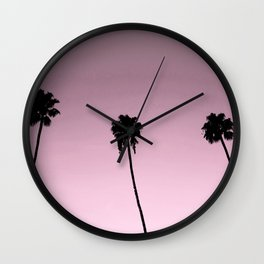 pink skies and palm trees Wall Clock