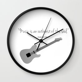 Guitars with a famous quote. Music is an outburst of the soul by Frederick delius Wall Clock