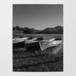 a black and white image of rowing boats moored at derwentwater Poster