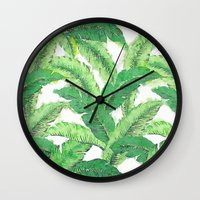 banana leaf Wall Clocks featuring Banana for banana leaf by Indulgencedecor