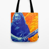 grateful dead Tote Bags featuring Jerry Garcia - The Grateful Dead by Tipsy Monkey