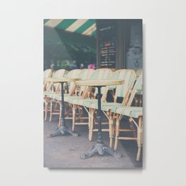 tables & chairs outside of a Paris cafe Metal Print