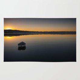 Boat on Knysna lagoon at Sunrise Rug