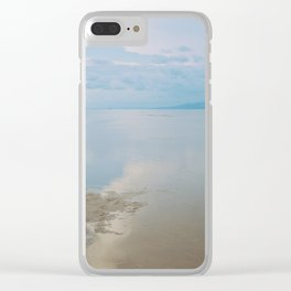A peaceful scene of a calm sea and sunset Clear iPhone Case