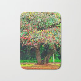 big tree with green yellow and red leaves Bath Mat