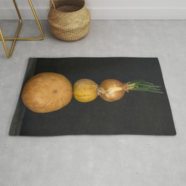 Still life with several pumpkins and sprouted onions Rug
