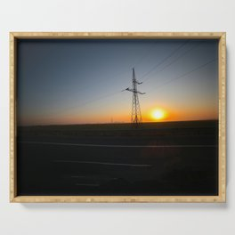 Sunrise with electric pole on the highway Serving Tray