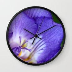 single purple flower Wall Clock