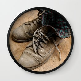 Pair of old leather shoes, worn-out and dusty, on wooden background Wall Clock
