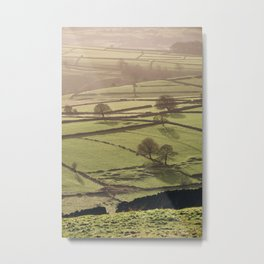 Hazy light at sunset over a valley of fields. Derbyshire, UK. Metal Print