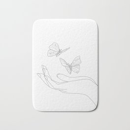 Butterflies on the Palm of the Hand Bath Mat