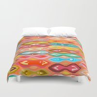 ikat Duvet Covers featuring Greeshma ikat by Sharon Turner